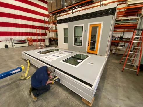 These $50,000 tiny homes unfold out of shipping containers and can be combined into custom houses — see inside
